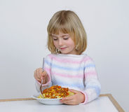 Little girl eats Royalty Free Stock Images