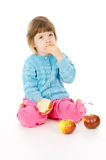 The little girl eats an Apple Royalty Free Stock Photo