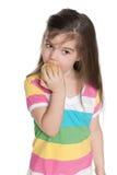Little girl eats an apple Stock Photo