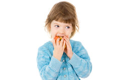 The little girl eats an Apple Royalty Free Stock Image