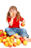 The little girl eats apples Royalty Free Stock Images