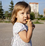 Little Girl Eats Bagel Stock Image