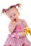 Little Girl Eats Banana Royalty Free Stock Image