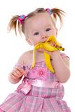 Little girl eats banana Royalty Free Stock Images