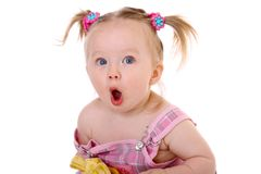 Little girl eats banana Royalty Free Stock Photography