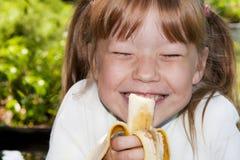 Little girl eats a banana Royalty Free Stock Images