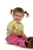 Little girl eats a banana Royalty Free Stock Photos