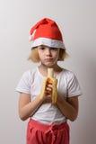 Little girl eats a banana Royalty Free Stock Photo