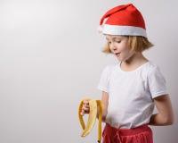 Little girl eats a banana Royalty Free Stock Image