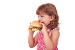 Little girl eats big sandwich Stock Images