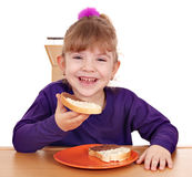 Little girl eats bread with chocolate Stock Image