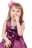 The little girl eats a candy Stock Images