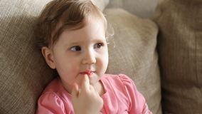 A little girl eats candy. stock video footage