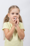 The little girl eats a chocolate sweet tooth. Portrait of a four-year European girls Kushan chocolate Stock Photography