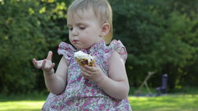 Little girl eats ice cream stock footage