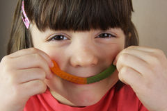 Child and gumdrops Stock Photography