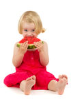 Little girl eats melon Royalty Free Stock Images