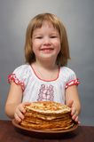 Little girl eats pancakes Stock Photo