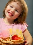 Little girl eats pancakes Royalty Free Stock Photos