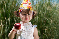 Little girl eats peach Stock Photo