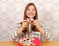 Little girl eats a pie with cherries Royalty Free Stock Images