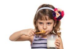 Little girl has her breakfast Stock Photos