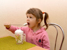 The little girl eats with a spoon oxygen cocktail. Phytobar of children's sanatorium. Food Stock Images
