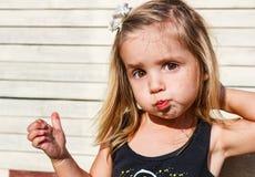 Little girl eats tasty chocolate Stock Photography