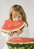 Little girl eats watermelon Royalty Free Stock Images