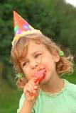 Little girl eats watermelon in garden Royalty Free Stock Images