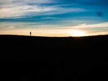 Little Girl of the Edge of the Hill. Nice moment, seeing the girl of the top of the hill. Walking on the edge with sunsetting behind her Royalty Free Stock Image