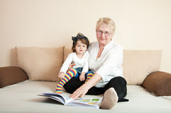 Little girl educated by grandmother Royalty Free Stock Photo