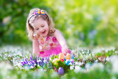 Little girl at egg hunt Royalty Free Stock Images