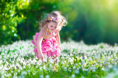 Little girl at egg hunt Stock Photo