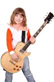 Little girl with electric guitar Royalty Free Stock Photos