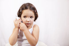 Little girl with electronic thermometer Royalty Free Stock Images