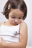 Little girl with electronic thermometer Stock Photography