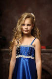 Little girl in an elegant blue dress Royalty Free Stock Photo