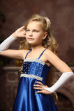 Little girl in an elegant blue dress Stock Image