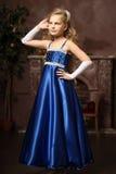 Little girl in an elegant blue dress. Blond little girl in an elegant blue dress Royalty Free Stock Photos