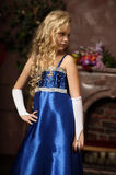 Little girl in an elegant blue dress Royalty Free Stock Photography