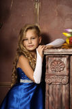 Little girl in an elegant blue dress Stock Photography