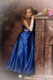 Little girl in an elegant blue dress. Blond little girl in an elegant blue dress Stock Image
