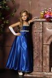 Little girl in an elegant blue dress. Blond little girl in an elegant blue dress Stock Photos