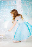 Little girl in an elegant dress driven sleigh Royalty Free Stock Photography