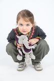 Little girl with elephant toy Stock Image