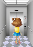 A little girl at the elevator Stock Image