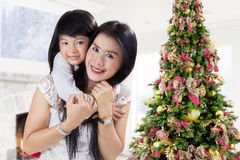 Little girl embrace her mother Stock Photos