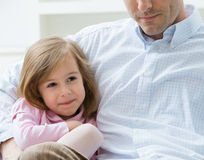 Little girl embraced by father Stock Photos