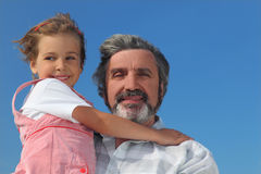 Little girl embracing grandfather Royalty Free Stock Photography